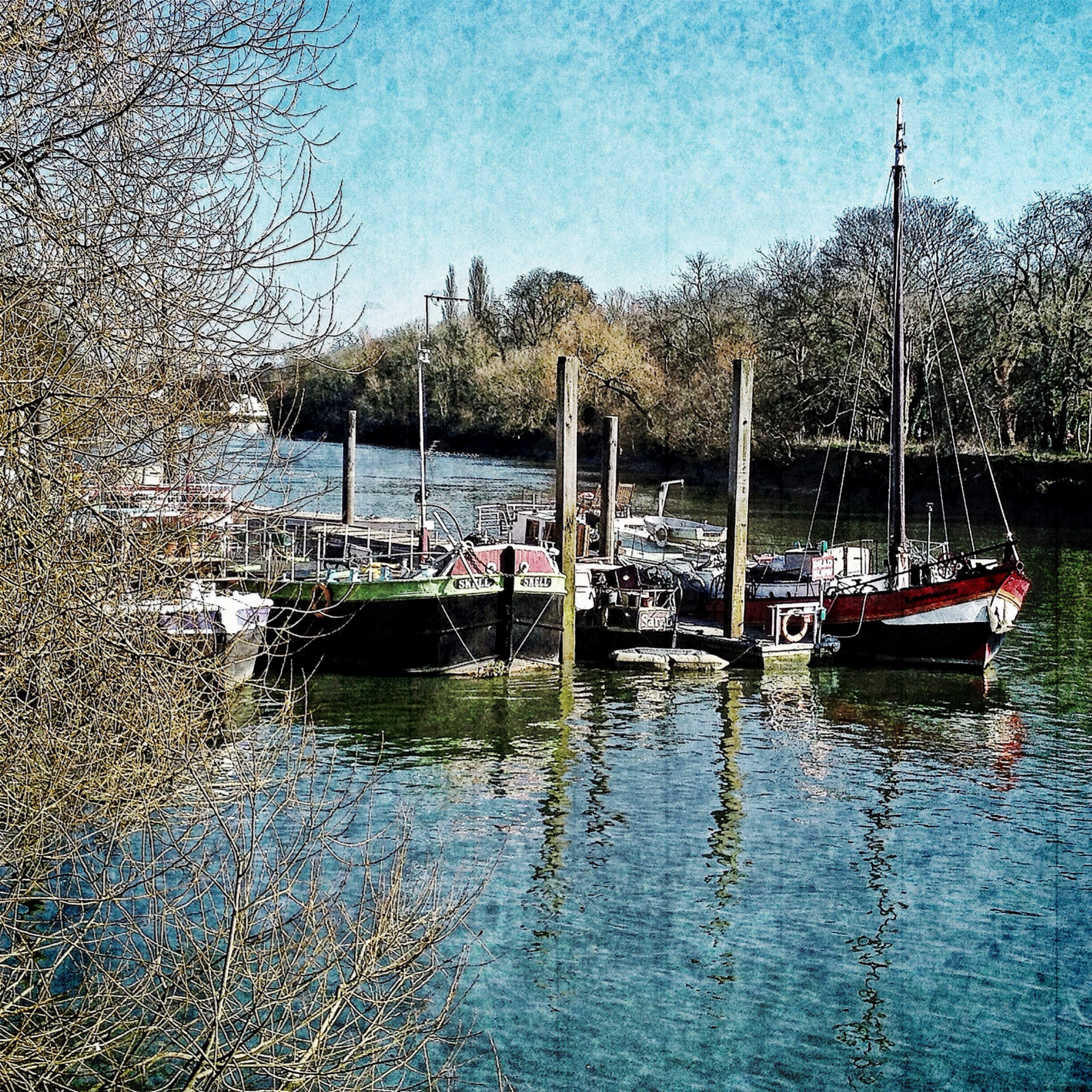 Veevs Hanson ~ Sun shines on the house boats